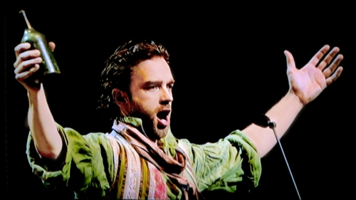 Hadley Fraser as Grantaire, with bottle once again, in the Les Miserables concert