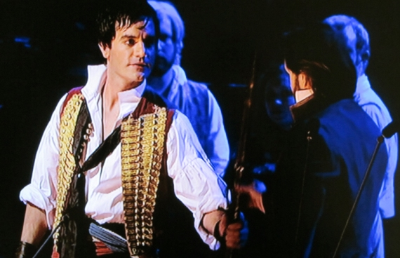 Ramin Karimloo and Alfie Boe with musket