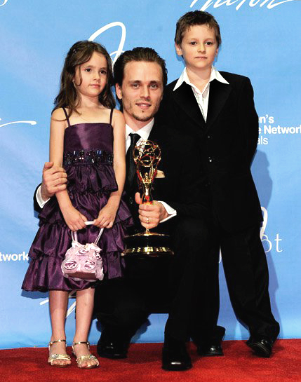 Jonathan Jackson with his daughter, older son, and the 2011 Supporting Actor Emmy