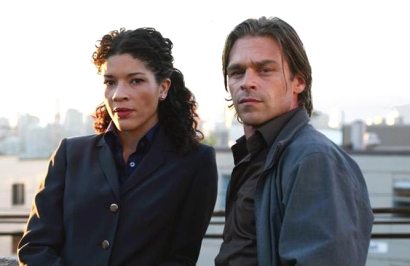 Klea Scott and Ian Tracey in Intelligence